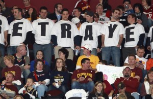 Image: Cleveland Cavaliers fans in Ohio wear shirts expressing their disappointment towards LeBron James, who was with the Cavaliers for seven years before leaving to play for the Miami Heat