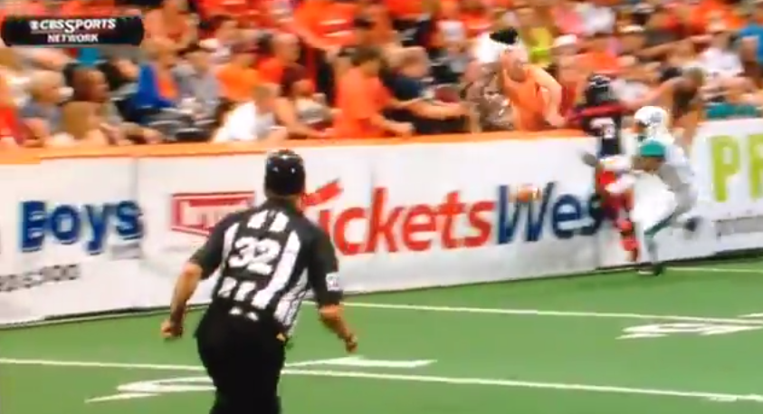 Video-Arena-Football-Fan-Gets-Crushed-Reaching-For-Ball